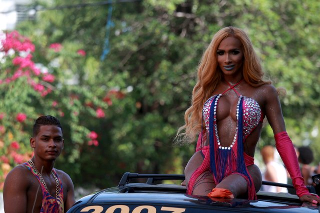 Revellers take part in a gay pride parade in Santo Domingo, in the Dominican Republic July 5, 2015. (Photo by Ricardo Rojas/Reuters)
