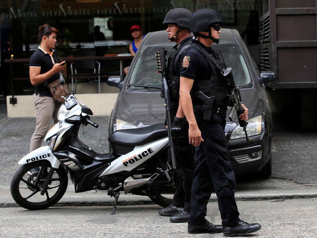 Members of the Philippine National Police (PNP) Special Weapons And Tactics (SWAT) patrol along a main street of metro Manila in the Philippines May 12, 2016. (Photo by Romeo Ranoco/Reuters)