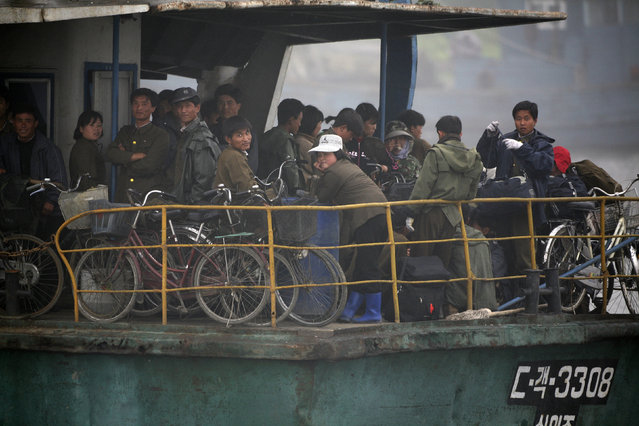 North Koreans take a boat tour on the Yalu River near the Chinese border city of Dandong, Liaoning province June 16, 2010. (Photo by Jacky Chen/Reuters)