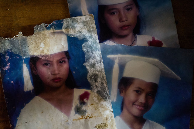 Salvaged graduation photos of Filipino sisters Jojo, left, Gemma, bottom right, and Joanne, top, in their home in the Visayas, Philippines. (Photo by Hannah Reyes Morales/The Washington Post)