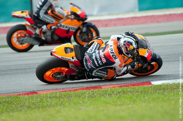 Dani Pedrosa of Spain  and Repsol Honda Team  rounds the bend during the third day of MotoGP testing at Sepang Circuit