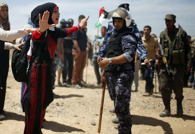 "A Palestinian protester argues with members of Palestinian security forces loyal to Hamas during a protest marking the 66th anniversary of Nakba, near the border of east Gaza City with Israel May 15, 2014. Palestinians marked ""Nakba"" (Catastrophe) on Thursday to commemorate the expulsion or fleeing of some 700,000 Palestinians from their homes in the war that led to the founding of Israel in 1948. (Photo by Mohammed Salem/Reuters)"
