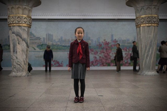 In a photo taken on April 10, 2017 student Jo Chong-A (10) poses for a portrait in a subway station of the Pyongyang metro. (Photo by Ed Jones/AFP Photo)
