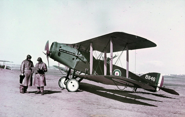 Captain Ross-Smith (left) and Observer in front of a Modern Bristol Fighter, 1st Squadron A.F.C. Palestine, February 1918. This image was taken using the Paget process, an early experiment in color photography. (Photo by Frank Hurley/State Library of New South Wales via The Atlantic)