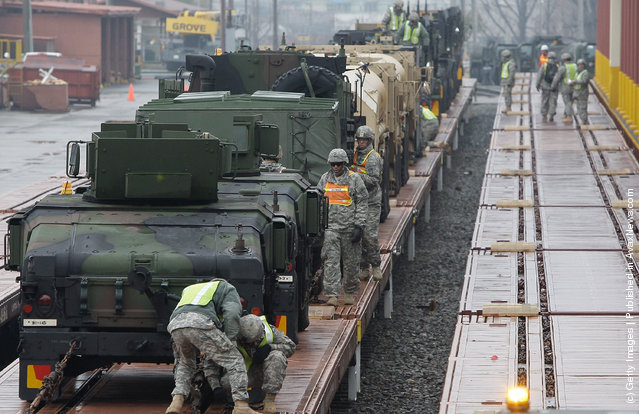 United States Forces Korea (USFK) including soldiers from the 1st Battery, 145th Field Artillery deployed from the United States, load equipment from APS-4 (Army Prepositioned Stocks) stocks onto the railhead during the Key Resolve/Foal Eagle exercise at Camp Carroll on March 6, 2012 in Waegwan, South Korea. The annual combined Field Training Exercise, part of Key Resolve/Foal Eagle 2012, is conducted between the Republic of Korea and United States Forces Korea (USFK) and is one of the largest annual military training exercises in the world
