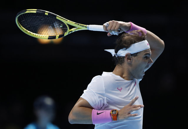 Spain's Rafael Nadal plays a return to Stefanos Tsitsipas of Greece during their ATP World Tours Finals singles tennis match at the O2 Arena in London, Friday, November 15, 2019. (Photo by Alastair Grant/AP Photo)