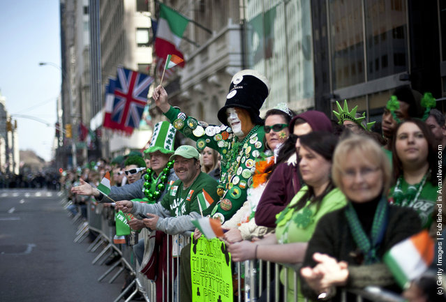 Revelers cheer on the marchers during the 251st annual St. Patrick's Day Parade March 17, 2012 in New York City