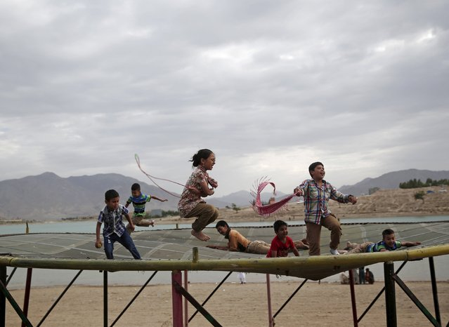 Afghan children play on a trampoline along Qargha lake in Kabul, Afghanistan July 21, 2015. (Photo by Ahmad Masood/Reuters)