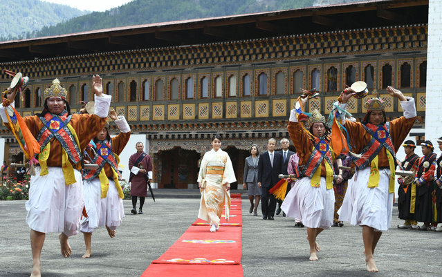 In this Friday, June 2, 2017 photo, Japanese Princess Mako dressed in Japan's traditional kimono walks on the red carpet during a welcome ceremony at Buddhist monastery and fortress Tashichhodzong in Timphu, Bhutan. Mako, the eldest granddaughter of Japan's Emperor Akihito, who is currently preparing for her engagement, is on a one-week visit to Bhutan. (Photo by Hitoshi Takano/Kyodo News via AP Photo)