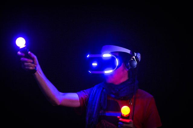 A visitor wears a virtual reality glasses the Sony Morpheus at the Gamescom 2015 gaming trade fair during the media day on August 5, 2015 in Cologne, Germany. Gamescom is the world's largest digital gaming trade fair and will be open to the public from August 6-9. (Photo by Sascha Schuermann/Getty Images)