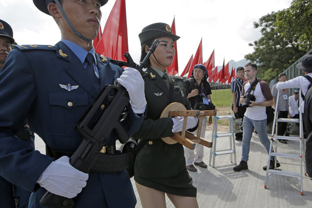 Chinese soldiers leave after Chinese President Xi Jinping inspected troops of People's Liberation Army (PLA) Hong Kong Garrison at the Shek Kong Barracks in Hong Kong, Friday, June 30, 2017. Xi landed in Hong Kong Thursday to mark the 20th anniversary of Beijing taking control of the former British colony, accompanied by a formidable layer of security as authorities showed little patience for pro-democracy protests. (Photo by Kin Cheung/AP Photo)