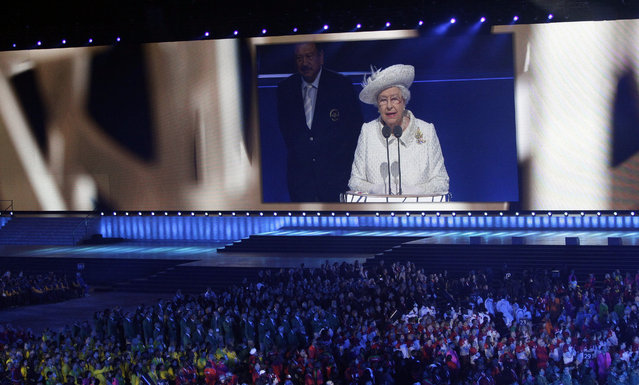 Britain's Queen Elizabeth II is seen on a large video screen as she speaks during the opening ceremony for the Commonwealth Games 2014 in Glasgow, Scotland, Wednesday, July 23, 2014. (Photo by Kirsty Wigglesworth/AP Photo)