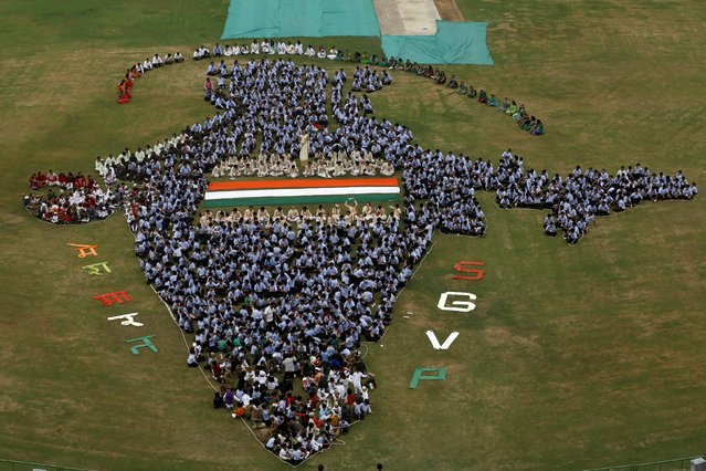 Students make a formation of a map of India inside the school premises during Independence Day celebrations in Ahmedabad, India, August 14, 2015. (Photo by Amit Dave/Reuters)