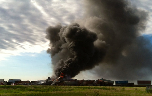 In this photo provided by Billy B. Brown, two freight trains are on fire Tuesday, June 28, 2016, after they collided and derailed near Panhandle, Texas. Texas Department of Public Safety Lt. Bryan Witt says the accident occurred Tuesday morning near the town of Panhandle, about 25 miles northeast of Amarillo. No injuries have been reported. (Photo by Billy B. Brown via AP Photo)