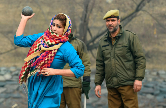 Kashmiri woman takes part in a physical test of a recruitment rally for the Special Police Officers (SPO) in Jammu and Kashmir Police, in Srinagar on December 6, 2019. As many as 23,000 people have applied for posts in the Special Police Officers (SPO) in Jammu and Kashmir Police and 100 positions will filled in the current phase of recruitment, local authorities said. (Photo by Tauseef Mustafa/AFP Photo)