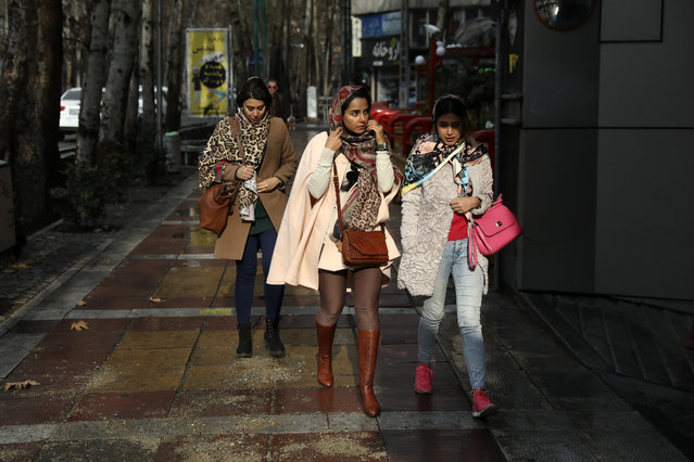 Women walk on a sidewalk in northern Tehran, Iran, Thursday, January 9, 2020. (Photo by Vahid Salemi/AP Photo)