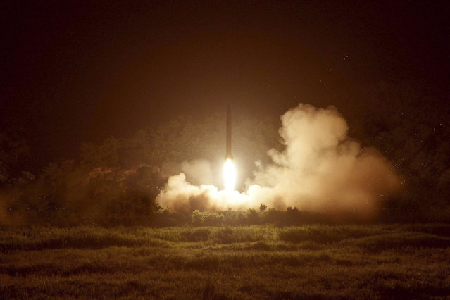A tactical rocket firing drill carried out by units of the Korean People's Army (KPA) Strategic Force is seen during a visit by North Korean leader Kim Jong Un in the western sector of the front in this undated photo released by North Korea's Korean Central News Agency (KCNA) in Pyongyang on July 10, 2014. (Photo by Reuters/KCNA)