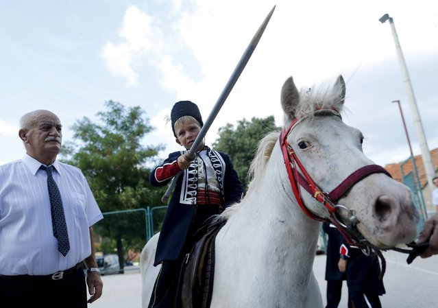 Alkar Vito poses for a picture on a horse before the Children's Alka competition in Vuckovici village, Croatia, August 23, 2015. (Photo by Antonio Bronic/Reuters)