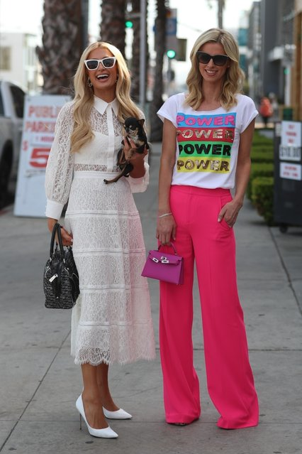Paris and Nicky Hilton pose up for photos after shopping together at Alice & Olivia in West Hollywood on March 5, 2020. (Photo by Backgrid USA)