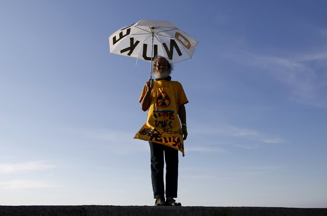 66-year-old Mitsuro Sudo poses for a photograph at the protesters' campsite near Kyushu Electric Power's Sendai nuclear power station in Satsumasendai, Kagoshima prefecture, Japan, August 8, 2015. (Photo by Issei Kato/Reuters)