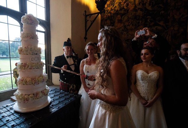 Debutante Eliza Lewis, 17 from Kent, who was named Debutante of the Year, cuts the cake with a sword at Leeds Castle during the Queen Charlotte's Ball on September 9, 2017 in Maidstone, England. In 1780 the first debutante's Ball was held by King George III to celebrate the birthday of his wife Queen Charlotte and raised money for a maternity hospital. Society girls were presented to the monarch and it became an annual event and important as a marriage market for the upper echelons of society. The London Season runs for six months of the year including sporting events, cocktail parties, dances and concerts and the Ball is the pinnacle of this season. After the present Queen terminated the practice of introducing debutantes at royal garden parties in 1957, Lady Howard de Walden followed by then editor of Tatler, Peter Townend, continued the tradition and on his death Peter nominated former debutantes Jennie Hallam-Peel and Patricia Woodall to take over running of The London Season. It is now focussed on raising money for children in need worldwide and the Queen Charlotte's Ball has been held in Shanghai and Dubai as well as various grand venues in London. This year the debutantes' gowns have been supplied by Berketex Brides and the cake, to which the debutantes curtsey, is made by Pretty Gorgeous Cakes. (Photo by Jack Taylor/Getty Images)