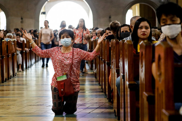 A Filipino Catholic wearing a protective mask amid a coronavirus scare kneels to pray during a mass on Ash Wednesday at the National Shrine of Our Mother of Perpetual Help, Paranaque City, Metro Manila, Philippines, February 26, 2020. (Photo by Eloisa Lopez/Reuters)