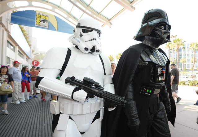 Fans dressed as Star Wars characters walk in front of the convention center on day three of the Comic-Con International held at the San Diego Convention Center Saturday, July 23, 2016 in San Diego.  (Photo by Denis Poroy/Invision/AP Photo)