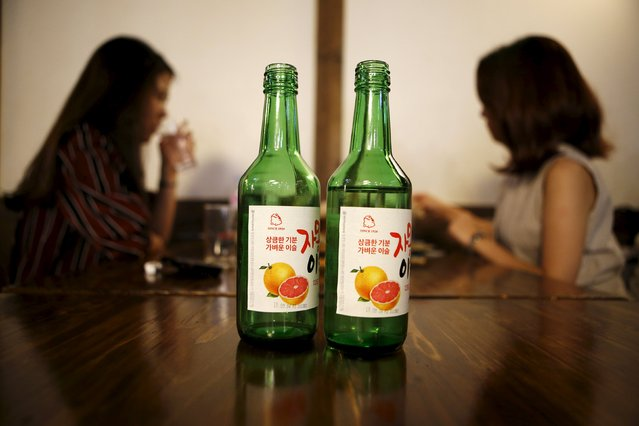 Bottles of fruit flavoured and low-alcohol soju are seen in this picture illustration at a pub in Seoul, South Korea, September 9, 2015. Professional women are driving a change in the way beverage companies look at South Korea, which hard-drinking men have made Asia's biggest alcohol consuming country on a per capita basis. (Photo by Kim Hong-Ji/Reuters)