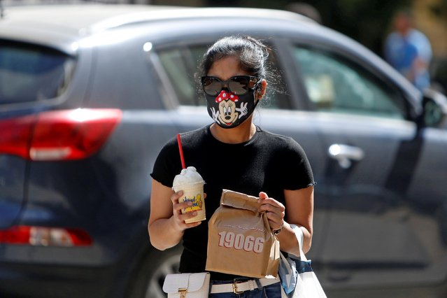 A woman wearing a protective face mask walks in Cairo, amidst concerns about the spread of the coronavirus disease (COVID-19), Egypt, May 4, 2020. (Photo by Mohamed Abd El Ghany/Reuters)