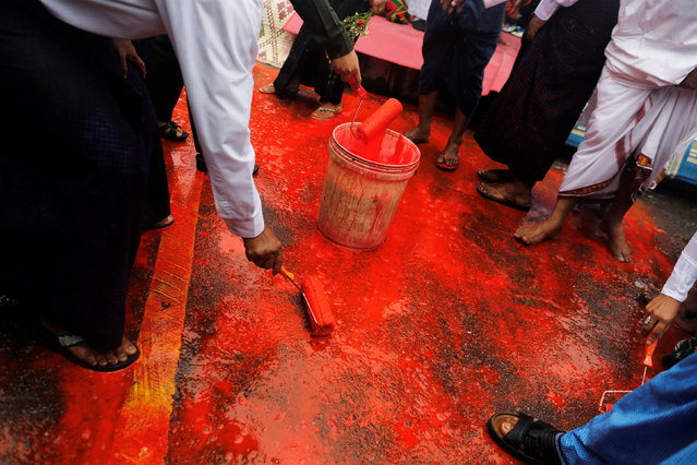 "Myanmar religious leaders paint the floor in red representing blood during a ceremony to mark the anniversary of the 1988 democratic uprising, also known as ""8888"" in the country formerly known as Burma in Yangon, Myanmar August 8, 2016. (Photo by Soe Zeya Tun/Reuters)"