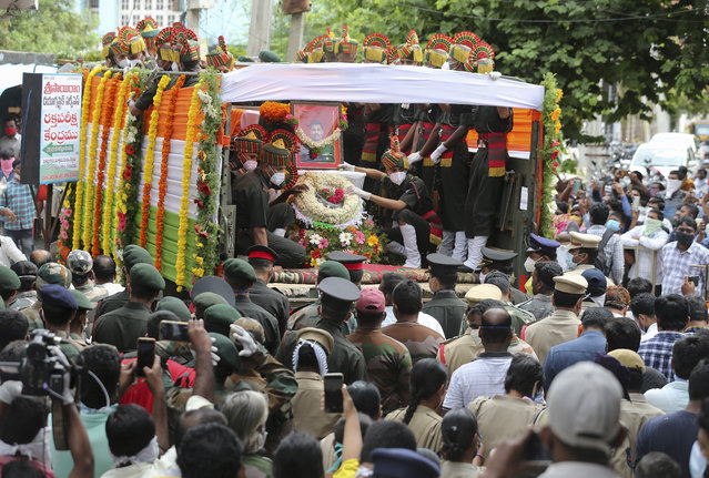 A truck carrying the coffin of Indian army officer Colonel B. Santosh Babu arrives in Suryapet, about 140 kilometers from Hyderabad, India, Thursday, June 18, 2020. (Photo by Mahesh Kumar A./AP Photo)