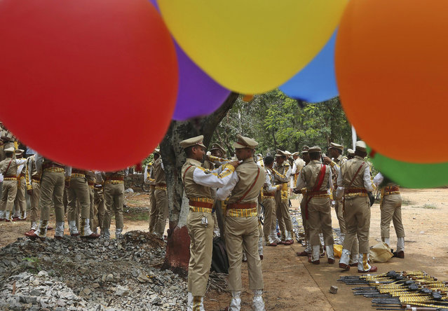 Balloons fly at the National Industrial Security Academy (NISA) as members of India's Central Industrial Security Force (CISF) prepare for a ceremonial parade on the outskirts of Hyderabad, India, Tuesday, September 8, 2015. The CISF is a paramilitary security force which provides security cover to nuclear installations, space establishments, airports, seaports, power plants, sensitive Government buildings and heritage monuments in India. (Photo by Mahesh Kumar A./AP Photo)