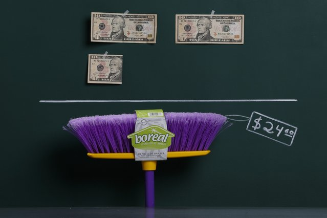 A household broom as photographed in a studio with an illustrative price tag of $24.60 (US dollars), equivalent to the Bs. 155 (bolivars) that it costs on average to purchase in Caracas at the official exchange rate of 6.3 bolivars per dollar, in Caracas September 29, 2014. (Photo by Carlos Garcia Rawlins/Reuters)