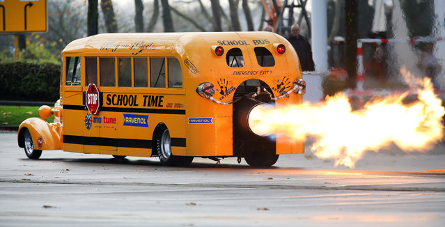 """Car designer Gerd Habermann launches his """"School Bus Jet"""" vehicle during a preview of the Essen Motor Show on November 29, 2017 in Essen, western Germany. The racing bus is powered by a 25,000 hp strong turbine. It is on display during the motor show running from December 2 to 10, 2017. (Photo by Roland Weihrauch/AFP Photo/DPA)"""