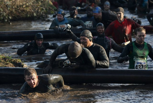 CCompetitors in action during the Tough Guy Challenge on January 27, 2013 in Telford, England.  (Photo by Ian Walton)