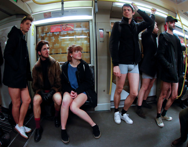 """People take part in the annual flash mob """"No Pants Subway Ride"""" in Berlin, Germany on January 7, 2018. (Photo by Hannibal Hanschke/Reuters)"""