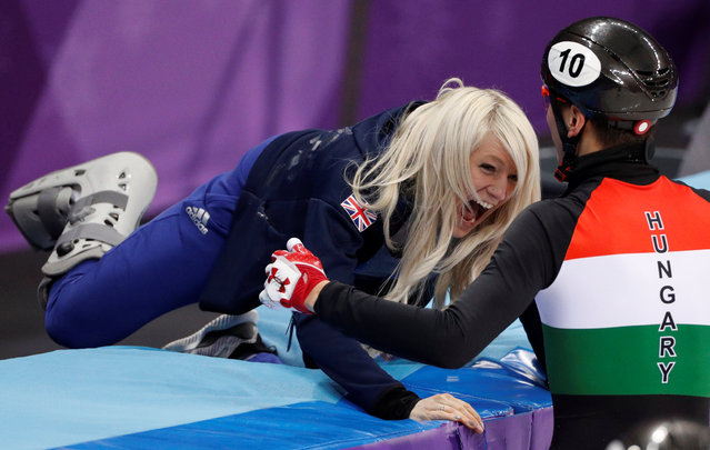 Shaolin Sandor Liu of Hungary celebrates with Elise Christie of Britain after his team' s win in the men' s 5000 meters short track speedskating relay final in the Gangneung Ice Arena at the 2018 Winter Olympics in Gangneung, South Korea, Thursday, February 22, 2018. (Photo by John Sibley/Reuters)