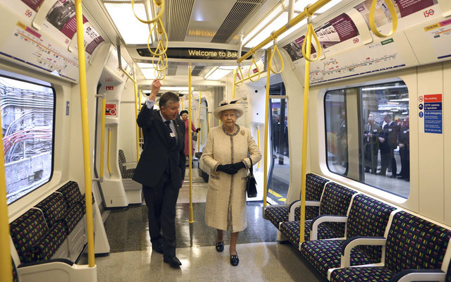 Britain's Queen Elizabeth speaks with Mike Brown, managing director of London Underground, as she inspects a tube train during her visit to Baker Street underground station in London March 20, 2013.The visit to the station on London's tube transport system, was to mark the 150th anniversary of the London Underground. (Photo by Chris Radburn/Reuters)