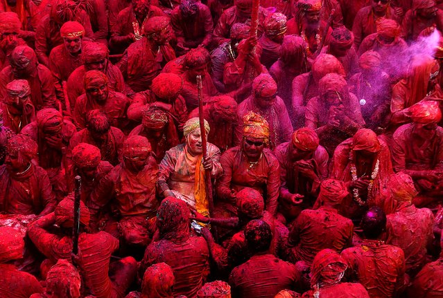 Devotees smeared with colors sing at the Nandagram temple, on March 22, 2013. (Photo by Manish Swarup/Associated Press)