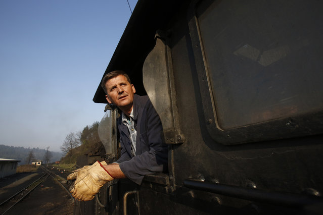 Bosnian worker Sefik Salihovic checks his cargo on the steam train at the coal mine of Oskova in the Bosnian town of Banovici, 140 kms (86.9 miles) north of Sarajevo, on Monday November 24, 2014. (Photo by Amel Emric/AP Photo)