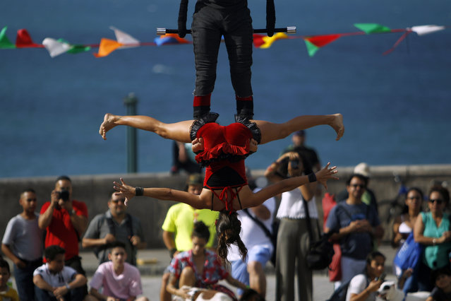 Members of the SubCielo company perform during the fifth annual Puerto Rico Circo Fest in San Juan, Puerto Rico, Saturday, March 10, 2018. (Photo by Ricardo Arduengo/AFP Photo)