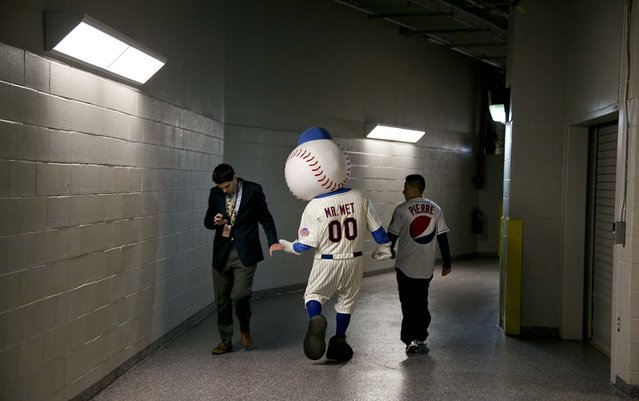 Mr. Met, the New York Mets' mascot, walks the halls of Citi Field in New York before the Mets' season opener against the Sand Diego Padres, on April 1, 2013. (Photo by Todd Heisler/The New York Times)