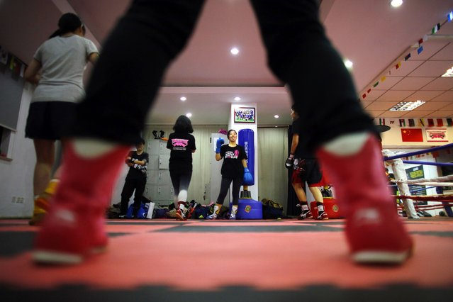 Women attend a boxing class at Princess Women's Boxing Club in Shanghai December 3, 2014. (Photo by Carlos Barria/Reuters)