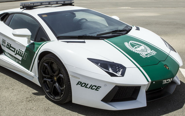 A Lamborghini Aventador is the latest addition to the Dubai Police fleet, on April 11, 2013. Dubai already has the world's tallest building, the world's largest shopping mall, and the largest man-made archipelago. So it's no surprise that the country's police would drive one of the world's most extravagant and expensive cars. The latest addition to the force's fleet is a head-turning Lamborghini Aventador, finished in green and white – the colors of the Dubai Police force. (Photo by AFP Photo/Polícia de Dubai)