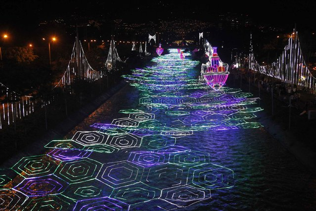 Christmas decorations light up the Medellin river in Medellin, Colombia, December 10, 2014. (Photo by Fredy Builes/Reuters)
