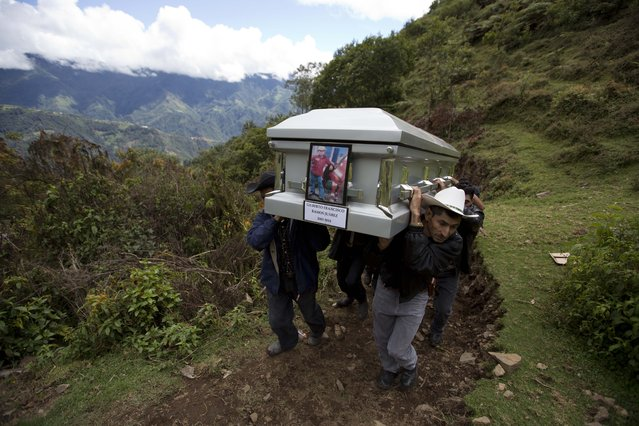 In this July 12, 2014 file photo, relatives carry the coffin of Gilberto Francisco Ramos Juarez, a Guatemalan boy whose decomposed body was found in the Rio Grande Valley of South Texas, to a local cemeteryin San Jose Las Flores, Guatemala. The 15-year-old Guatemalan migrant was buried in his hometown nearly a month after he became a symbol of the perils facing unaccompanied children who have been flooding illegally into the U.S. (Photo by Moises Castillo/AP Photo)