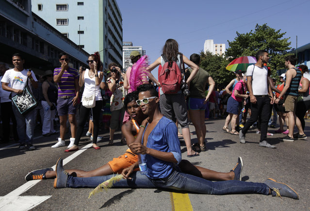 People take part in a gay pride parade during ahead of International Day Against Homophobia in Havana May 10, 2014. (Photo by Enrique de la Osa/Reuters)