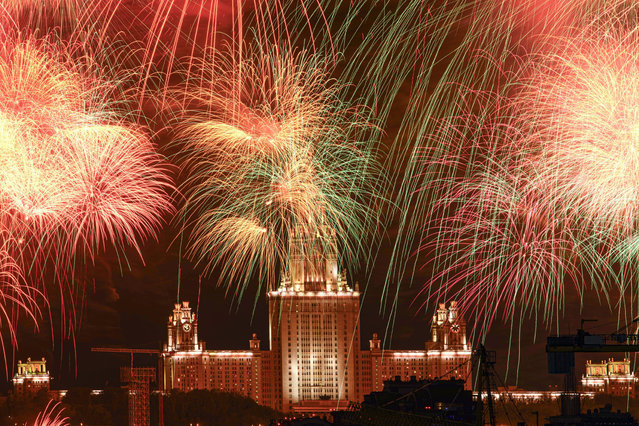 Fireworks explode over Moscow State University during the celebration of the 75th anniversary of the Nazi defeat in World War II in Moscow, Russia, Saturday, May 9, 2020. Russian President Vladimir Putin has marked Victory Day, the anniversary of the defeat of Nazi Germany in World War II, in a ceremony shorn of its usual military parade and pomp by the coronavirus pandemic. (Photo by Maxim Marmur/AP Photo)