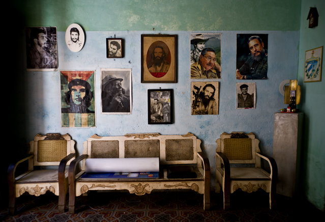 """In this March 15, 2016 file photo, images of revolutionary hero Ernesto """"Che"""" Guevara, Camilo Cienfuegos , Fidel Castro, Cuban President Raul Castro, and singer Compay Segundo, adorn a wall, in Havana, Cuba. Despite a series of reforms under Raul Castro, Cuba remains locked in grinding economic stagnation that has driven hundreds of thousands of Cubans to emigrate in search of better lives. (Photo by Ramon Espinosa/AP Photo)"""