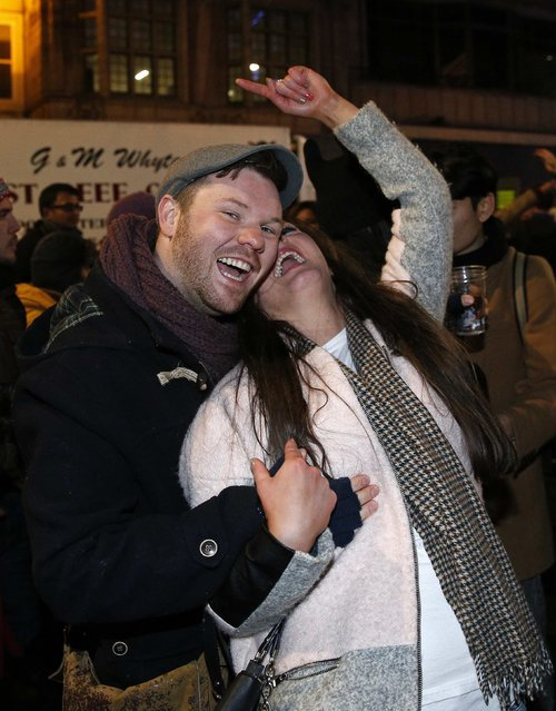 Revellers celebrate the New Year in Princes Street during Hogmanay street party celebrations in Edinburgh, Scotland January 1, 2015. (Photo by Russell Cheyne/Reuters)